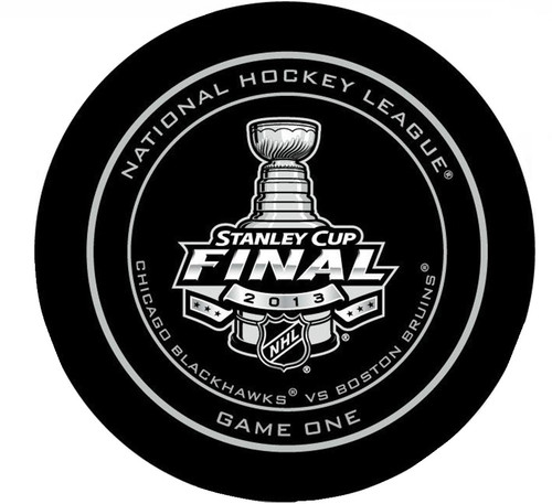 2013 NHL Stanley Cup Finals Boston Bruins vs. Chicago Blackhawks Game 1 Puck in a plastic case with NHL hologram sticker seal. Official Game Puck made by Sher-Wood.
