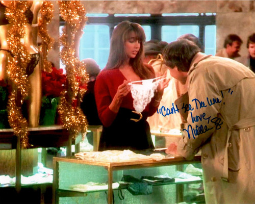 "A&R Collectibles is pleased to offer autographed 8x10 Christmas Vacation movie photos from our Exclusive private signings with Nicolette.  Ms. Scorsese has signed this photo and added the special message ""Can't See the Line"""