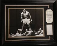 "A&R Collectibles EXCLUSIVE item features the Historic Ali over Liston photograph matted and framed with an actual piece of a fight robe once worn by ""The Greatest""...Muhammad Ali."