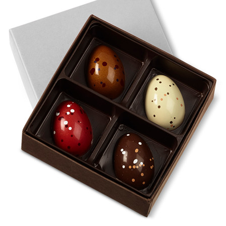 Experience four irresistible flavors: one each of Malted Milk Chocolate, Dark Chocolate Cognac, Peanut Butter & Cassis Pâté de Fruit, and Strawberries & Cream.