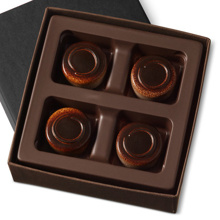 Smooth dark chocolate coffee ganache comes together with a layer of creamy mascarpone in a dark chocolate shell in a four piece gift box.