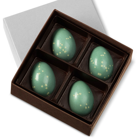 Hand-painted milk chocolate shell filled with a refreshing mint ganache in a four-piece box.
