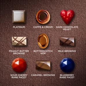 Experience a diverse sampling of chocolates including one of each: Platinum, Caffé & Cream, Dark Chocolate Heart, Peanut Butter Brownie, Butterscotch Hop, Milk Brownie, Sour Cherry Rare Facet, Caramel Brownie and Blueberry Rare Facet.
