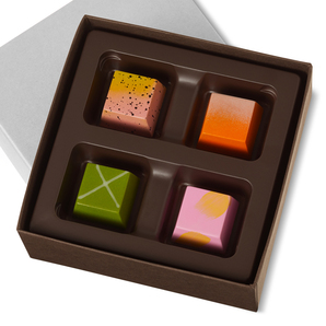 Dark chocolate shell filled with spring-inspired ganache flavors including one of each: Pink Lemonade, Orange Dream, Key Lime and Watermelon.