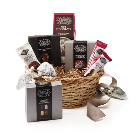 Basket Includes: HOT CHOCOLATE, PEPPERMINT CRUNCH TERRAPINS Four Pieces, VARIETY HOLIDAY CARAMELS Four Pieces, BUTTERSCOTCH HOP Four Pieces, SAVORY DARK CHOCOLATE One and One Half Ounces, MILK CHOCOLATE PEANUT BUTTER One and One Half Ounces and ORIGINAL BUTTERY TERRAPIN Two Pieces