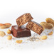KOHLER Original Recipe Peanut Butter Protein Bars  surrounded by peanuts.