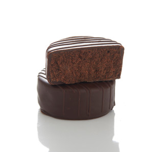 Smooth. Rich. Sugar free. Artfully crafted from 65% cacao imported from France, our Sugar Free Chocolates are the luxurious combination of artisan craftsmanship and unforgettable flavor. Velvety ganache, with hints of vanilla, is enrobed in rich chocolate and topped with a hand-crafted drizzle. It's hard to believe that sugar free can taste this good.