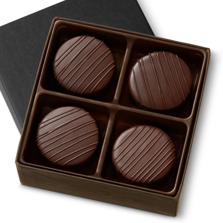 Smooth. Rich. Sugar free. Artfully crafted from 65% cacao imported from France, our Sugar Free Chocolates are the luxurious combination of artisan craftsmanship and unforgettable flavor. Velvety ganache, with hints of vanilla, is enrobed in rich chocolate and topped with a hand-crafted drizzle. It's hard to believe that sugar free can taste this good. Four-Piece Box