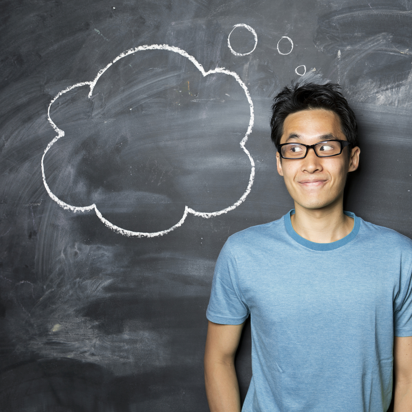 chinese-man-standing-next-to-thought-bubble-drawn-on-chalkboard-000029506162-medium.jpg