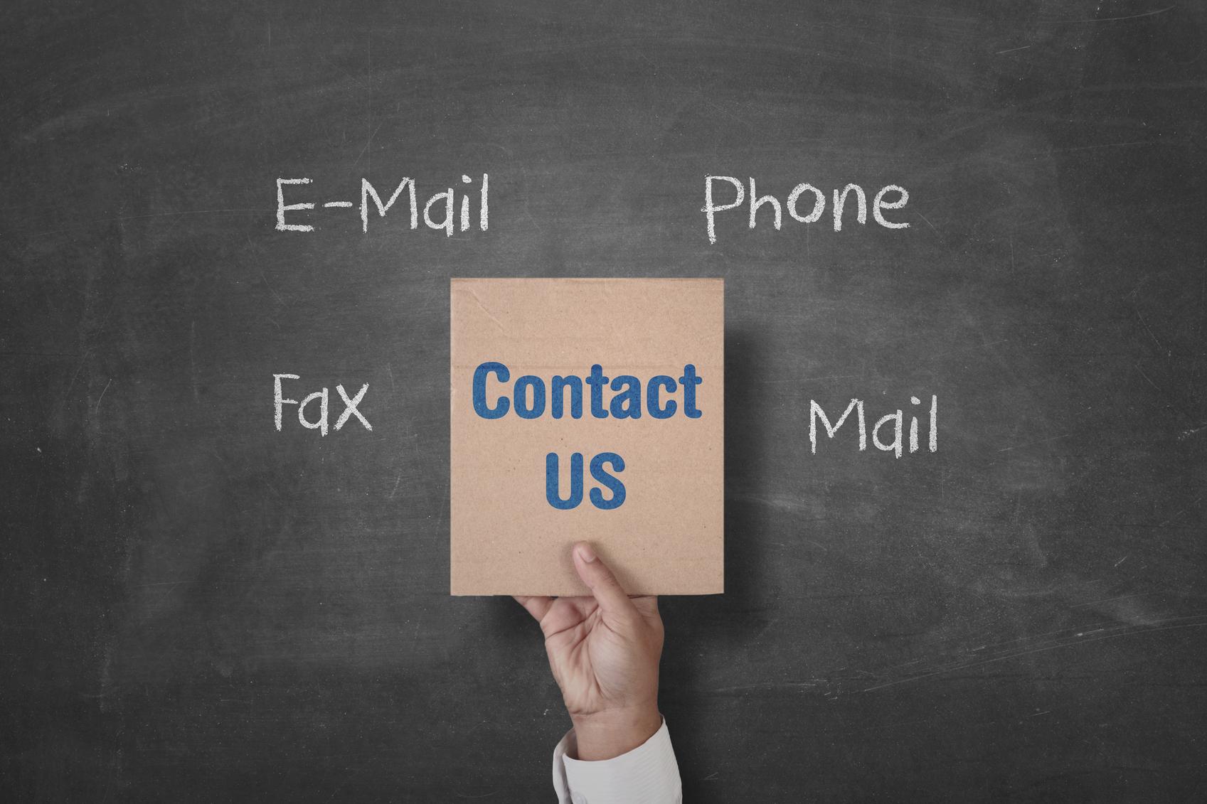 hand-holding-contact-us-placard-000090048333-medium.jpg