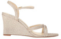 Touch Ups Buffy Champagne Wedge Sandal  This is a classic wedge with a 3 inch heel that features a criss cross on the  vamp with a adjustable strap with buckle. Completes this comfortable style with just the right amount of fit.
