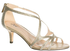 Taxi Chanel Champagne Dress Sandal. If you need to look sharp in a wider fitting sandal, this is the one for you.  Delicately decorated with jewels to beautify this nifty dress sandal. Perfect for that special occasion.