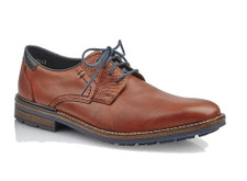 Rieker B1321-25 Men's Tan Lace Shoes Rieker B1321-25 These brownish tan smart casual shoes hava a smooth leather uppers with a textured overlay panels on the back heel and quarters. Contrasting navy laces match the navy trim around the colar and outsole for a modern look. Pair these shoes with jeans and a plaid shirt for a smart casual look. Buy Rieker shoes online at www.moosecreekmall.com or at our brick and motar store, Vimi Shoes. We are a official Rieker vendor.