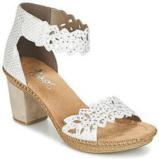 Rieker 66555-80 Women's White Dress Sandal The Rieker 66555-80 stunning ladies sandals will take you from day to night with your outfits and essentials. Uppers are enhanced by metallic hightlights paired with cut out details and rhinestone embillishments on the straps. Buy your Rierker sandals at Moose Creek Mall from Vimi Shoes.