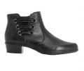 The Rieker Y07B0-00 black bootie is a perfect little casual boot to wear with dressy pants. A velour lining is perfect for cooler weather and an inside zip make them very easy to take them off and on. New style found at Vimi Shoes in Moose Creek Mall.
