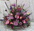 Wicker basket filled with striking purple and pink hues.