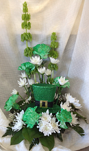 Green carnations, white mums, bells of ireland and a sparkly Irish hat.