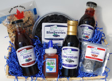 The Healthy Basket! Contains  one each of the following items: 12 fluid ounce bottle Blueberry Apple Juice,  12 fluid ounce bottle Blueberry Cranberry Juice, 6.5 ounce Blueberry Blossom Honey, 1 pound Blueberry Maple Pecan Granola Mix, 3 ounce Dried Cherries, 2 pound Dried Blueberries, and 12 fluid ounce bottle Blueberry Concentrate in a shrink wrapped basket with a beautiful blue bow. Basket style and design may vary.