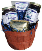 The Merry Berry Basket contains one package 3 ounce Dried Blueberries, one 11 ounce jar Blueberries Foster, one 2 ounce package Blueberry Coffee, and 10 ounce jar Blueberry Jam in a shrink wrapped basket with a beautiful blue bow. Basket style and design may vary.