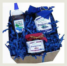 The Berry Essentials Basket contains 10.5 ounce Old Fashioned Blueberry Preserves, 6.5 ounce Blueberry Honey, and 4.5 ounce Triple Berry Preserves in a shrink wrapped basket with a beautiful blue bow. Basket style and design may vary.