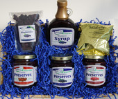 The No Sugar Added Basket contains one jar each of 11.5 ounce No Sugar Added Blueberry, Cherry, and Red Raspberry Preserves, 12 fluid ounce bottle No Sugar Added Blueberry Syrup, 2 ounce  Blueberry Coffee, and a 3 ounce Unsweetened Dried Blueberries.  Basket is shrink wrapped and tied with a blue bow. Basket style and design may vary.
