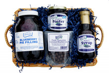 This basket is full of our tastiest dessert toppings and fillings, as well as some chocolate covered blueberries for your snacking pleasure!  Blueberries Divine Basket contains: Contains: 35oz. Blueberry Pie Filling, 11oz. Blueberries Foster, 14oz. Blueberry Syrup, 4oz. Dark Chocolate Covered Blueberries. All items are neatly packaged in a basket, shrink wrapped, and topped off with a beautiful blue bow. Basket style and design may vary.