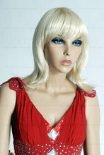 In this closeup view, mannequin Echo wears a shoulder length blond wig with a fire-engine red formal dress.. With pierced ears, she can display earrings and jewelry.  Glass stand and support hardware included.