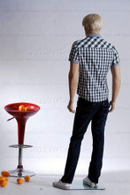 In this full body rear view photo, wearing a short blond wig / hairpiece, blue jeans, tennis shoes, and a plaid short-sleeved shirt, mannequin Alex stands with his left leg slighly forward along with his left arm while his right remains back - both at about hip level.  Mannequin Alex can be displayed with or without a wig / hairpiece.  Glass stand and support hardware included.