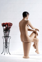 In this full body rear view, naked mannequin Ruby sits with her right leg crossed over her left and her right hand resting on her right knee. Her left hand rests on her left knee.   With pierced ears, mannequin Ruby can display earrings and jewelry.  Pedestal included.