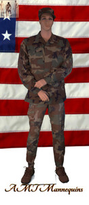 In this full body rear view photo, wearing a military field dress with boots,  mannequin Bill, stands with his legs even, his arms raised to his waist with his left hand almost touching his right arm.  Mannequin Bill can be displayed with or without a wig / hairpiece.  Glass stand and support hardware included.