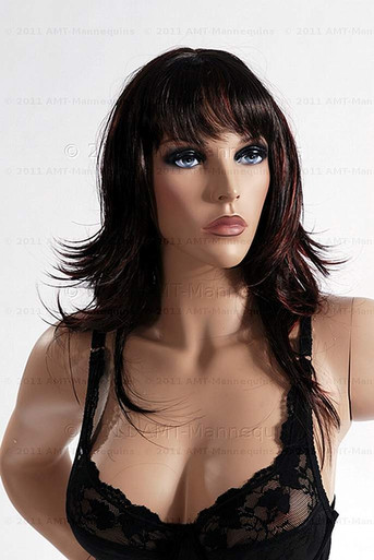 In this closeup, mannequin Julie wears a dark brunette wig with a black lace bra. With pierced ears, she can display earrings and jewelry.