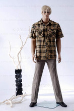 In this full body view photo, wearing a short blond wig / hairpiece, grey slacks, black loafers, and a tan plaid shirt, mannequin Ed, stands with his legs apart in even stance with his arms straight at his sides.  Mannequin Ed can be displayed with or without a wig / hairpiece.  Glass stand and support hardware included.
