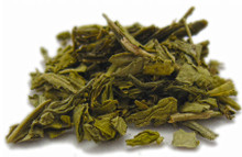 Sencha tea is a Japanese traditional green tea with tightly rolled, needle-shaped leaves picked in early spring after the leaves have developed their balance of sweetness and astringency. The tea has a bright color, and a clean finish, with a taste somewhat reminiscent of seaweed. True Sencha differs in character from most Chinese-style green teas not only with its sleek dark green appearance, but its higher green notes compared to nuttier, vegetal notes. Low in caffeine.