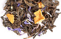 Rich chocolate and sweet orange bring a confectionary note to the gentle earthiness of pu erh. Lively citrus lifts the blend while the warm chocolate and easygoing pu erh are grounding and smooth. Reminiscent of a favorite treat.
