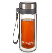 Enjoy loose tea on the go with our new portable tea tumbler. It sports a stainless steel infuser, tough borosilicate glass inside and out, a flexible strap for ease of transport and double-wall construction to maintain temperature. Holds 10 delicious ounces. This double-wall glass travel tumbler is fitted with a cap that fits both the glass container and the plastic infuser, allowing one to stop the infusion and prevent tea from growing bitter.