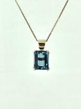 14KT Yellow Gold Emerald Cut Blue Topaz Pendant