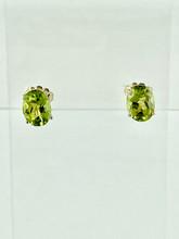 14 Karat Yellow Gold Oval Peridot Earrings