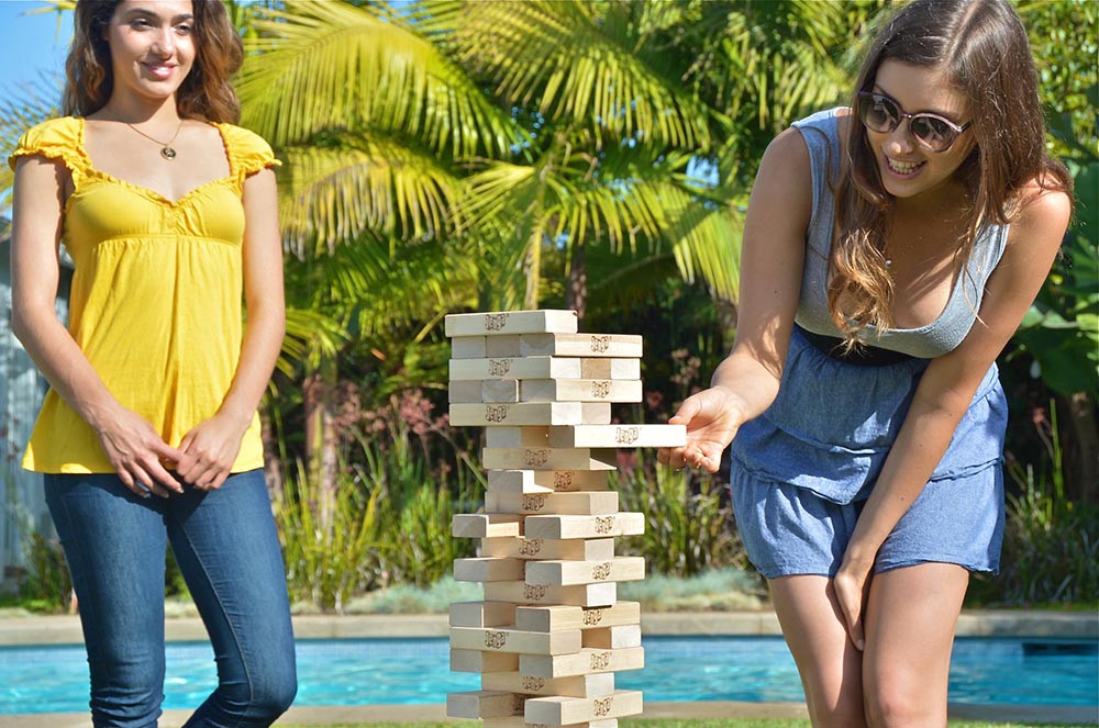 Girls playing a Jenga® GIANT™ game at a Graduation Party