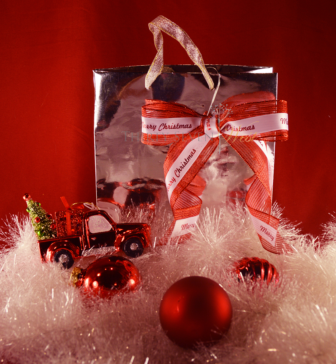 ideas-for-gift-wrapping.-silver-metallic-gift-bag.-personalized-custom-printed-ribbon-with-logo.-red-and-white-ribbon..jpg