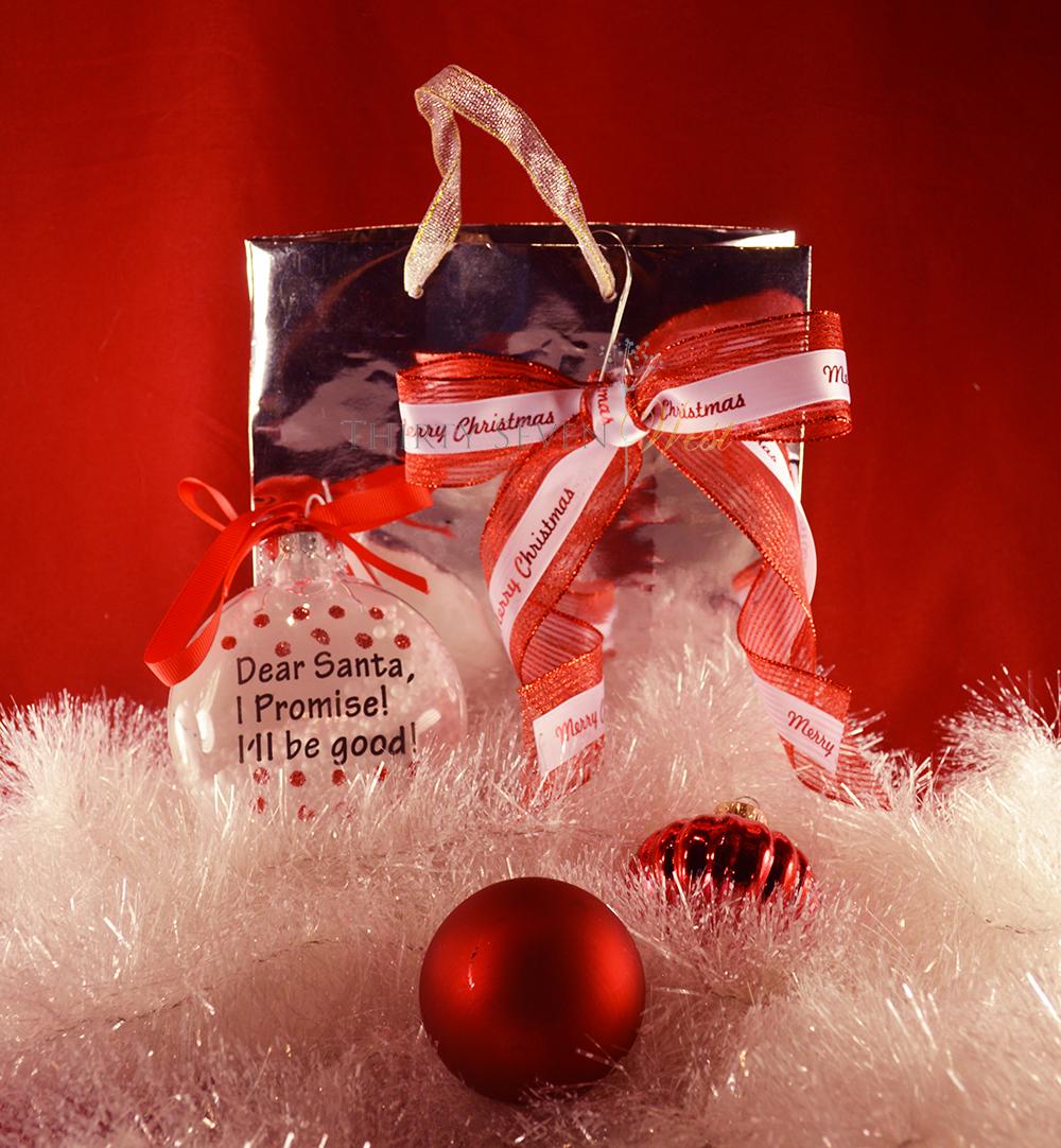 Custom gift wrap using a gift bag and personalized custom ribbon or custom Logo Ribbon.