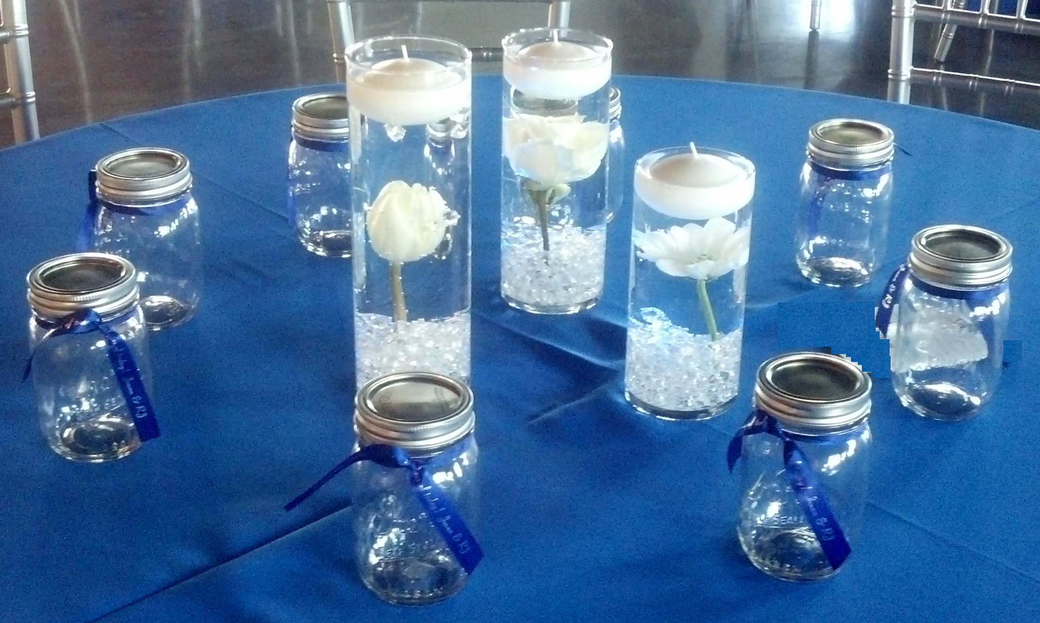 mason-jars-with-ribbon-ready-for-filling-at-the-candy-table-img-20140309-145555-558-colors-altered-no-pad.jpg