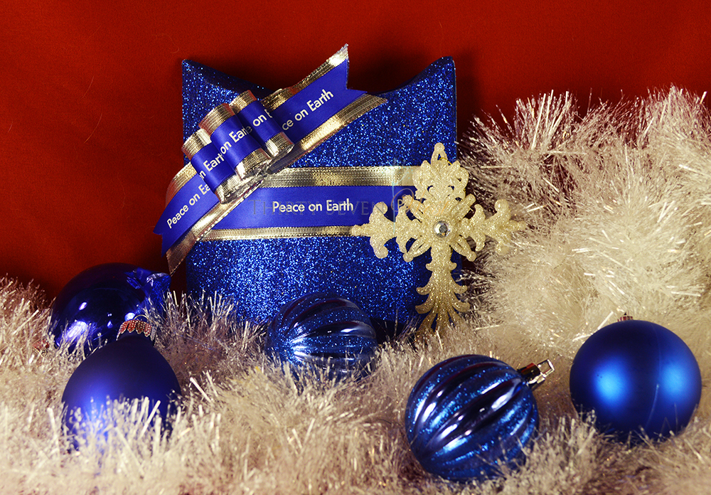 ustom Printed Ribbon in Blue and silver. Stunning and elegant combination for any gift package for Christmas or Hanukkah gifts.  Customize ribbon with your logo or a personal or corporate message. A great keepsake for any occasion!  Adding a cross or other religious or spiritual symbol personalizes it even more.