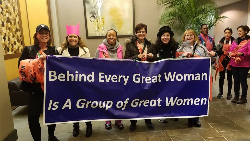 womens-march-on-washington-2017-sashes-behind-every-great-woman-is-a-group-of-great-women-banner-by-grace-killelea-bus-captain-philly.jpg