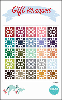 """Gift Wrapped  Finished Quilt Size 70 ½"""" x 70 ½""""  Finished Block Size 12"""" x 12""""    A perfectly wrapped quilt made with fat quarters.  Requirements  Blocks - 1 fat quarter bundle (25 FQ)  Background: 3 ⅛ yards   Binding: ⅝ yard   Backing: 4 ½ yards  Batting: 76"""" x 76"""""""
