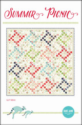 """Summer Picnic  Jelly Roll Friendly  Finished Quilt Size 76 ½"""" x 76 ½""""  Finished Block Size 18"""" x 18""""  Requirements  4 strips of assorted red prints 2 ½"""" x width of fabric, 4 strips of assorted green prints - 2 ½"""" x width of fabric 4 strips of assorted aqua prints - 2 ½"""" x width of fabric 4 strips of assorted navy prints - 2 ½"""" x width of fabric 4 strips of assorted light coral prints - 2 ½"""" x width of fabric Background prints: 4 ¾ yards of assorted light prints including remaining fabric from border print. Border print / background print: 2 ¼ yards Binding: ¾ yard Backing: 4 ¾ yards Batting: 82"""" x 82"""""""