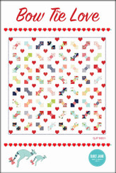 "Bow Tie Love  Finished Quilt Size 75 ½"" x 75 ½""  Finished Block Size 18"" x 18""    A traditional bow tie block with some added love.      Requirements  Bows: 1 - fat eighth bundle (or 38 - 9"" x 22"" pieces)  Background: 4 ¾ yards  Red fabric 1:  1 - fat quarter 18"" x 22""   Red fabric 2:  ½ yard  Binding: ⅝ yard  Backing: 4 ¾ yards  Batting: 82"" x 82"""