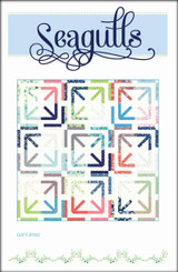 "Seagulls  Finished block size: 12"" x 12""  Finished quilt size: 72 ½"" x 72 ½""    Imagine seagulls scrambling for a hot chip, leaving their footprints in the sand. A simple and quick quilt made with one layer cake and your favourite Bella solid.     Requirements  1 Layer Cake  Background fabric: 4 ½ yards  Binding: ¾ yard  Backing: 4 ½ yards 4  Batting: 78"" x 78"""