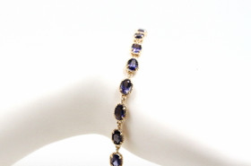 "14K Yellow Gold Oval Tanzanite 7.5"" Bracelet By Shin Brothers Jewelers Inc."