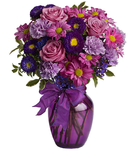 Does someone you know love the colour purple? If so, they'll love this enchanting bouquet of fresh flowers in royal hues of lavender, lilac and violet, all dressed up with a purple satin bow! It's a charming way to display your affection at Mother's Day, Valentine's, Just Because....you name the occasion!