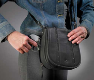 Stylish over-flap design for feather weight concealed carry handbag